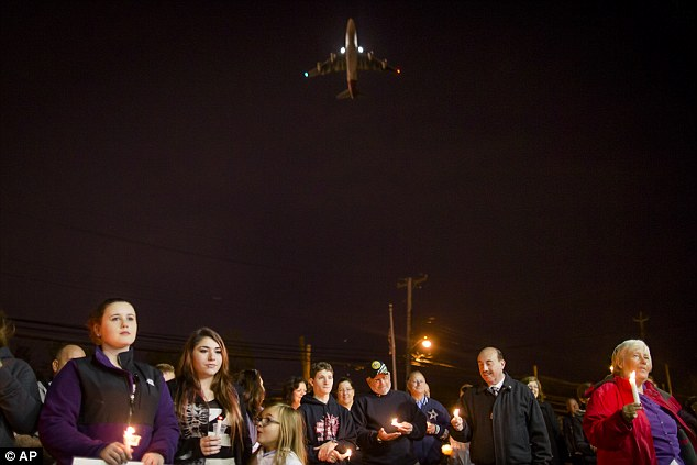 Breezy Point residents held their candlelight vigil in West Hamilton, NY. Photo credit: AP