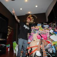 Chris Brown left his rehab facility for the day to host a toy drive for underprivileged kids at Brooklyn Projects Melrose in L.A. Image Credit: Splash News