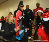 Ciara (tryna hide her bump) and fiance rapper Future handed out toys and clothes alongside former football star Tyrone Poole at Bessie Branham Park in Atlanta. Image Credit: The Source