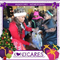 RHOA star Kandi Burruss held a toy drive through her Kandi Cares non-profit for kids of single parents in Atlanta. Image Credit: Kandi Online