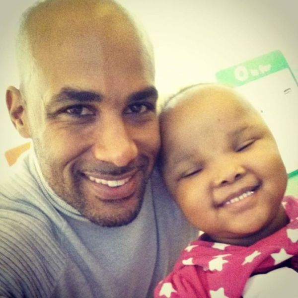 Boris brigtening little Kamani's day at St. Jude's. Photo Credit: Boris Kodjoe IG