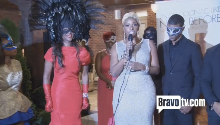 Nene giving her infamous speech to supporters of Saving Our Daughters, while Kenya looks on.  Image Credit: LoveBScott.com