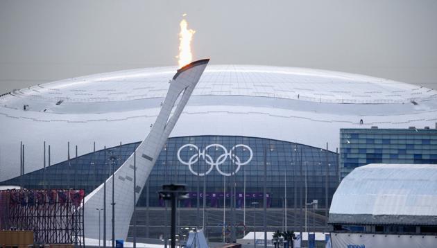 The Olympic flame burning brightly over Bolshoy Ice Dome. Image Credit: Yahoo Finance