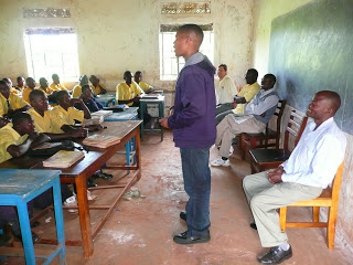 Gaius Charles chattin with kids at a secondary school in Uganda in 2011. Image Credit: Indiegogo.com
