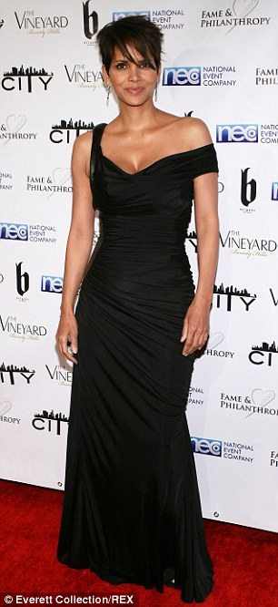 Halle Berry looking super gorg at the Fame & Philanthropy party in Beverly Hills.  Image Courtesy: Daily Mail