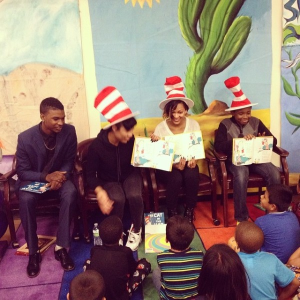 Meagan Good reading to the children. Image Credit: IG
