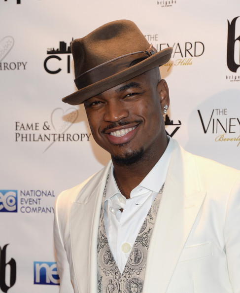 Neyo cheesin at the Fame & Philanthropy party. Image Credit: Zimbio