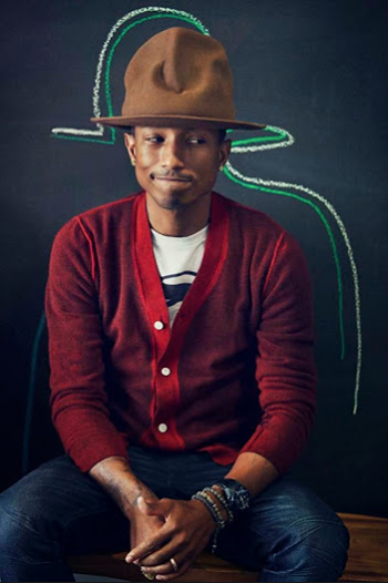 Pharrell being eaten by the smokey the bear hat. Image Courtesy: Facebook
