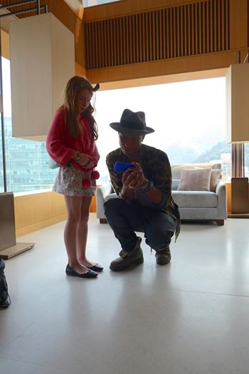 Pharrell chillin with 9-year-old Poppy who shoots and edits her own music videos. Image Courtesy: Facebook