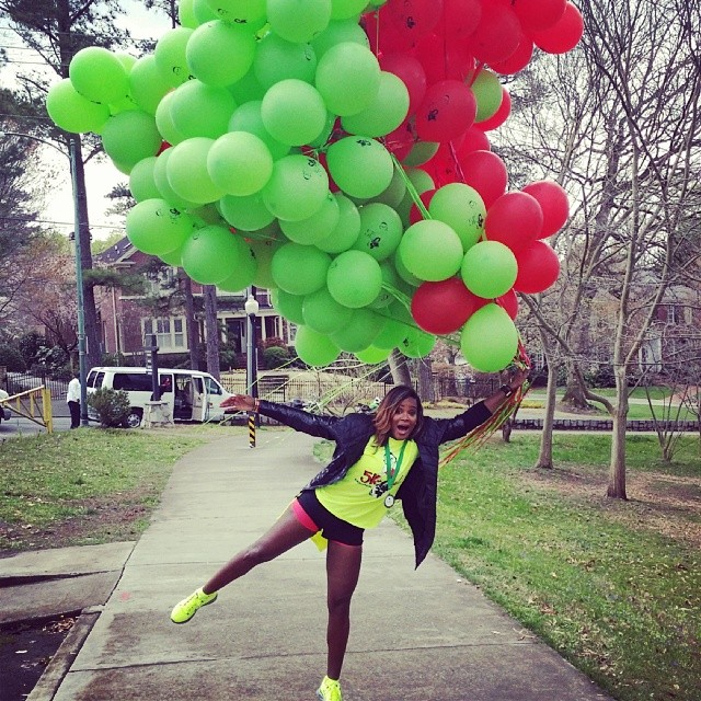 Big Red and Green balloons ready to lift off before the start of the 5K run/walk event. Image Courtesy: Instagram