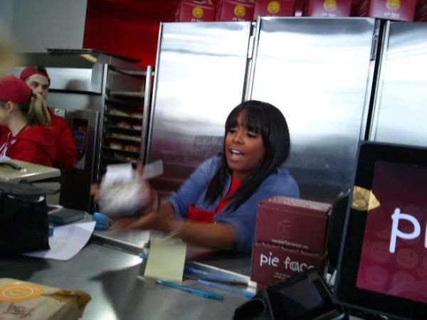Keshia Knight Pulliam ringing people up. She worked hard for Kamp Kizzy. Image Courtesy: Moi