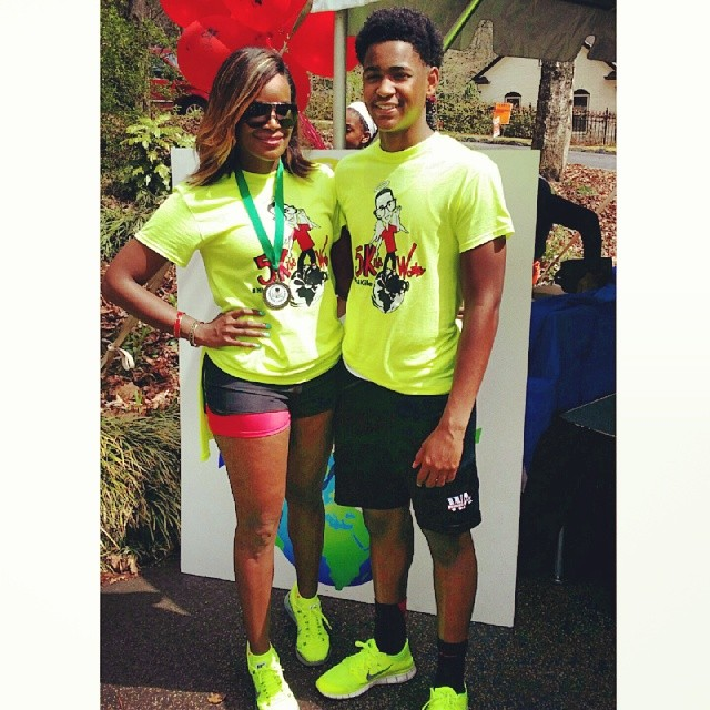 Tameka posing with her older son at Kiles 5K race and walk event. Image Courtesy: Instagram