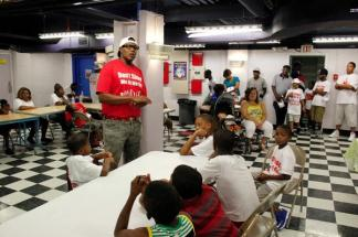 Percy Miller aka Master P talking to kids about his Let Kids Grow Foundation. Image Courtesy: Plugged Entertainment Magazine