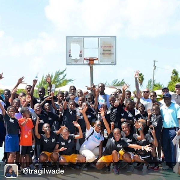 Dwayne Wade in Turks & Caicos with kids from Sandal Foundation. Image Courtesy: Instagram