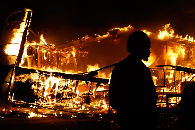 A burning building in Ferguson. Image Courtesy of Jim Young Reuters