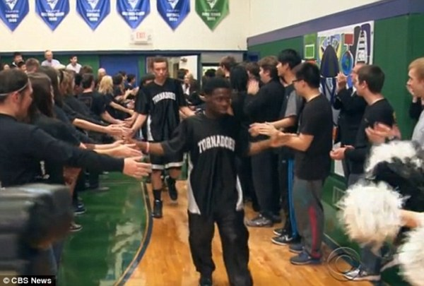 The Gainesville Texas  Tornadoes make a surprising entrance into the game. Photo courtesy:  CBS News