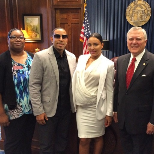 Ludacris surrounded by lawmakers and pregnant wife Eudoxie. Photo Courtesy: ludacrisfdtn instagram