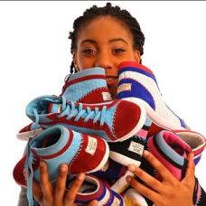 Mo'ne Davis holding her newly unveiled sneaker collection.  Photo Courtesy: ShoesbyMade Instagram