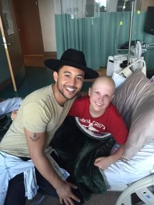 Tahj Mowry with Kacey at   Rady Children's Hospital.