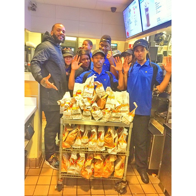Look ma, no hands. The Game and McDonald's workers in Ferguson. Image Courtesy: LOS ANGELES CONFIDENTIAL instagram